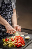 Chef is slicing vegetables Royalty Free Stock Image