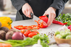 The chef slicing vegetables. Stock Photography