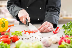 The chef slicing vegetables. Royalty Free Stock Photo