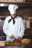 Chef slicing vegetables Royalty Free Stock Image