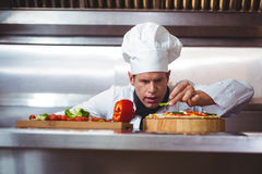 Chef slicing vegetables to put on a pizza Stock Image