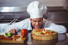 Chef slicing vegetables to put on a pizza Stock Images