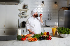 Chef smell aroma of fresh tomato Royalty Free Stock Images