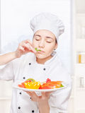 Chef smell mint before putting it on a plate Royalty Free Stock Image