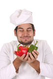 Chef smelling the aroma of peppers Stock Image