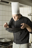 Chef smelling Food Royalty Free Stock Image