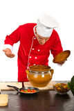 Chef smelling food. Against white background stock images