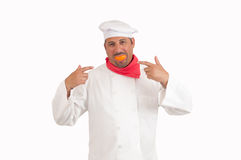 Chef smiling with orange Stock Photo