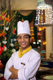 Chef smiling at work. Portrait of chef smiling at gala dinner buffet Stock Photography