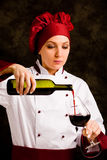 Chef Somelier pouring wine Stock Photography