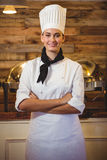 Chef standing with arms crossed. Chefs standing with arms crossed in a restaurant royalty free stock images