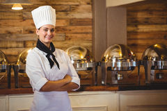 Chef standing with arms crossed. In a restaurant stock photo