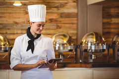 Chef standing with arms crossed. In a restaurant royalty free stock photography