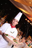 Chef standing in gala dinner. Chef standing in new year gala dinner Royalty Free Stock Images