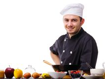 Chef standing with hand on his side on a white isolated background royalty free stock photography
