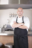 Chef Standing Next To Cooker In Kitchen Stock Photos