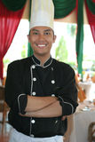 Chef standing at restaurant. With big smile royalty free stock photos