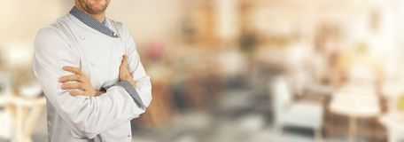 Chef standing in restaurant with crossed arms. banner. Copy space stock images