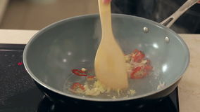 Chef Stewing Garlic, Onion, Ginger and Chili with stock footage
