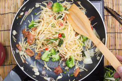 Chef stir fried Spaghetti with ladle Stock Images