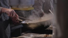 Chef Is Stirring Noodles With Vegetables And Meat In Wok stock video