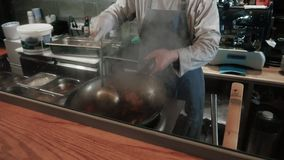 Chef Is Stirring Vegetables With Meat In Wok At Commercial Kitchen, Pan-Asian cuisine stock video