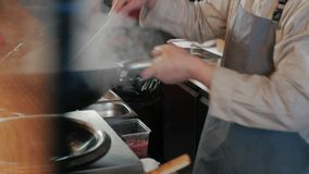 Chef Is Stirring Vegetables With Meat In Wok At Commercial Kitchen, Pan-Asian cuisine stock footage