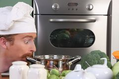 Chef strange looking at pot Stock Photo