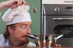 Chef strange looking at pot Stock Photography