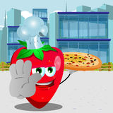 Chef strawberry with pizza holding a stop sign in the city Royalty Free Stock Image