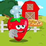 Chef strawberry with pizza pointing at viewer on a farm Stock Photography