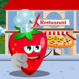 Chef strawberry with pizza pointing at viewer in front of a restaurant Stock Photo