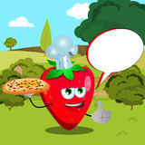 Chef strawberry with pizza showing thumb up on a meadow with speech bubble Royalty Free Stock Image