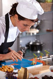 Chef styling an amuse. Chef preparing an amuse very carefully with pincers Stock Image