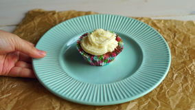Chef take away dessert plate with cupcake. Tasty cup cake on cake plate stock video footage