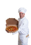 Chef take out. A smiling chef holding a pizza in a take out box Royalty Free Stock Photography