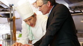 Chef talking with employer stock video footage