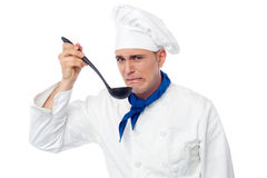 Chef tastes awful food. Young male chef tastes awful food stock image