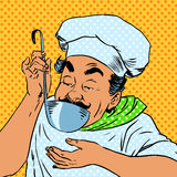 Chef tastes food kitchen Stock Photography