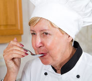 Chef tasting food royalty free stock image