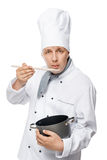 Chef tasting food in a pot on a white Royalty Free Stock Images