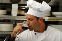 Chef tasting a glass of wine Royalty Free Stock Images