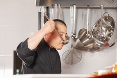 Chef tasting the meal Stock Images