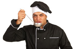 Chef tasting soup from ladle Stock Images