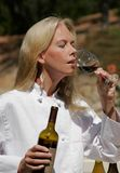Chef Tasting Wine. Woman Chef tasting red wine outdoors Royalty Free Stock Image