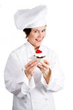 Chef - Tasty Pastry. Chef holding a delicious cheesecake tart.  Isolated on white Stock Image