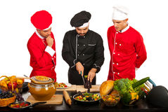 Chef teacher with students in kitchen Royalty Free Stock Photos