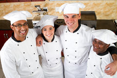 Chef team. Group of professional chef hugging form a team Royalty Free Stock Images