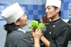 Chef team. Pose in kitchen royalty free stock images