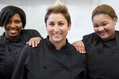 The chef team. Three chefs standing together inside white kitchen royalty free stock photos